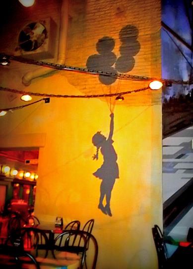 girl-and-balloons-on-wall